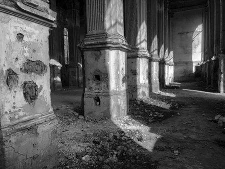 Burnt abandoned interior of an old catholic church in Ukraine, background for mystical kozharovaniya.