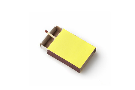 Matches made of natural wood for fire yellow boxes, on a white background, the concept of security. Reklamní fotografie