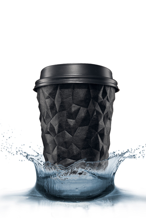 A cup of textured coffee geometry with a cap is black on a white isolate splash of water. Reklamní fotografie