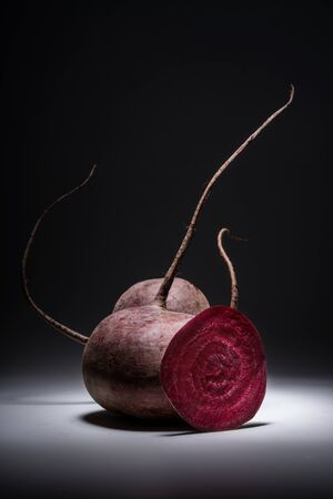 Natural Red Beet Vegetable Composition, vitamins vegan volumetric light view from the front.