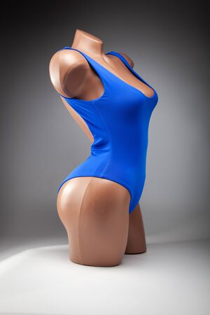 Clothes on a female mannequin, stylish marine swimsuit. Fashion things for relaxation at the pool.