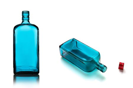 Empty alcohol bottles of different color glass. White isolate background. Stock fotó