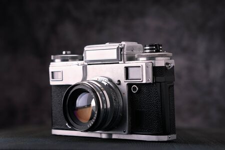 Old vintage film 36mm photo camera, lifestyle memory. Take pictures with a manual lens history.