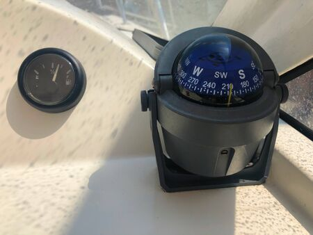 Marine device on a yacht - the hero compass shows the direction of movement, navigation in the ocean. Safety of sailing first, the idea of ??travel.