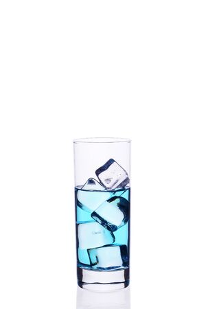 Glass with ice cubes isolate white
