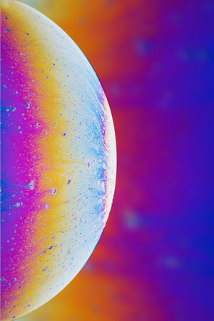 Abstraction  multi-colored soap bubble in the form of a space planet. Zdjęcie Seryjne