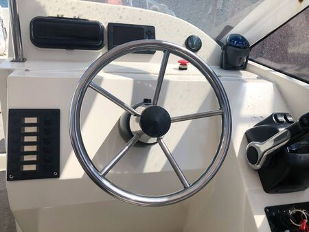 View of yacht cockpit on the deck. The helm of the sea boat, motor boat, coast guard, saving lives.
