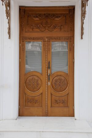 Old antique wooden front door of the house, security from theft and attackers. Protects from weather phenomena. Mystical passage. Zdjęcie Seryjne - 131879310