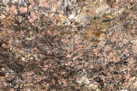Texture of natural rock granite natural rock granite, magmatic structure with quartz and mica and traces of erosion and oxide.