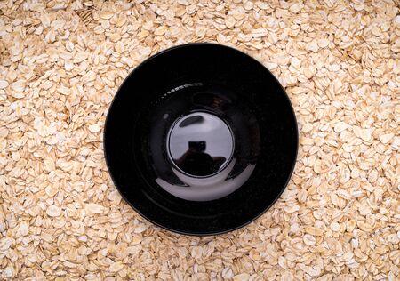 Natural oatmeal flakes, healthy food ingredients with vitamins. Zdjęcie Seryjne