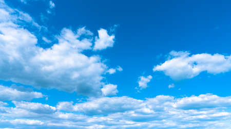 Landscape white clouds on a blue sky, atmospheric weather phenomenon, natural chaotic forms created by nature.