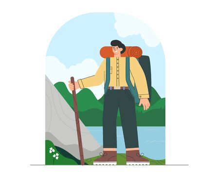 Young man in hiking clothes and backpack, standing on nature background, mountains, forests, natural landscape. Tourist holding a stick.