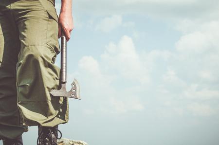hatchet: Man holding the hatchet