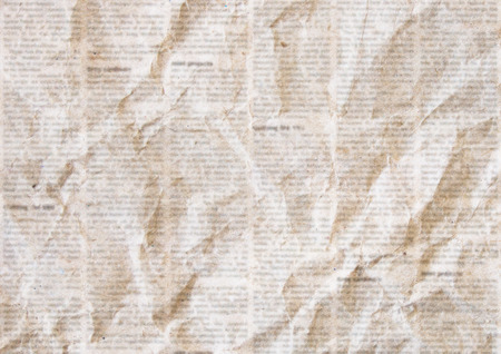 Old crumpled grunge newspaper paper texture background. Blurred vintage newspaper background. Crumpled paper textured page. Sepia color collage news paper background. Foto de archivo