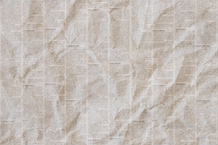 Old crumpled grunge newspaper paper texture background.