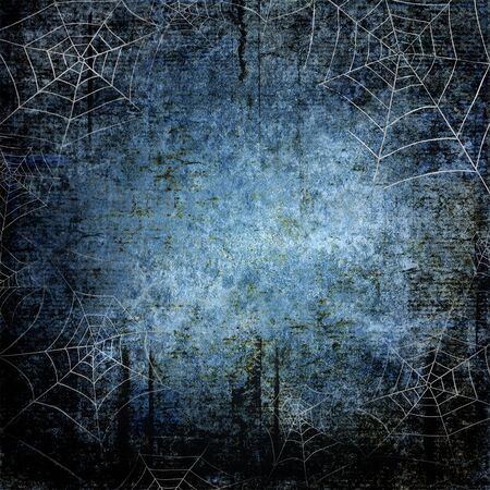 Halloween blue navy gray grunge background with silhouettes of spider webs on dark spooky night sky. Halloween, horror concept. Space for text.