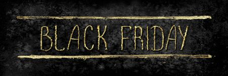 Black Friday sale glitter background. Gold shiny glittering hand drawn lettering on black watercolor texture. Watercolour horizontal illustration. Stock Photo