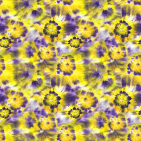 Tie dye shibori seamless pattern. Watercolor hand painted yellow and purple elements on white background. Watercolour abstract flowers texture. Print for textile, fabric, wallpaper, wrapping paper.