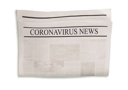 Coronavirus Covid-19 news. Newspaper with headlines on horizontal surface. Old newspapers background. Aged news pages texture. Gray white black paper collage. Top view.