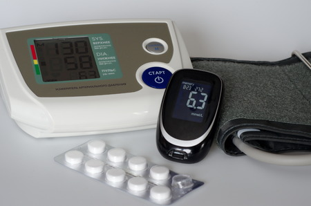 exceeding: Medical devices blood pressure monitor and glucometer Stock Photo