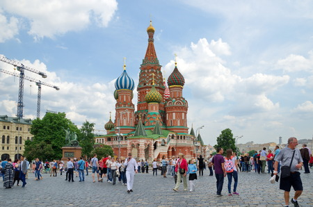 minin: Moscow, Russia - may 27, 2016: Tourists near the Church of St. Basil the blessed on red square