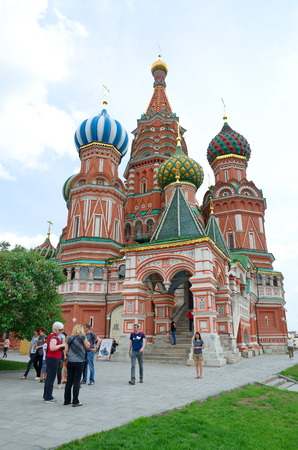 Moscow, Russia - may 27, 2016: Tourists near the Church of St. Basil the blessed on red square