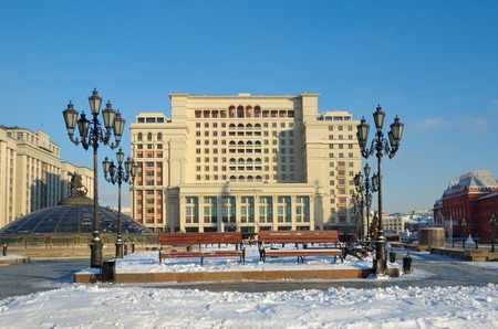 duma: Moscow, Russia - December 16: Manege square. View of the hotel Four seasons and the building of the State Duma in the new year holidays