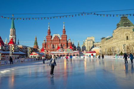 Moscow, Russia - December 7, 2016: The GUM-skating rink on the red square in Moscow. People ride on skates Editorial