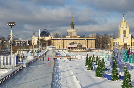 enea: Moscow, Russia - January 18, 2017: The ice rink at VDNKH on the background of the pavilion Ukraine, Space and the fountain Stone flower Editorial
