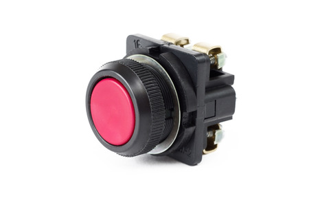 black appliances: Red push button switch on white background