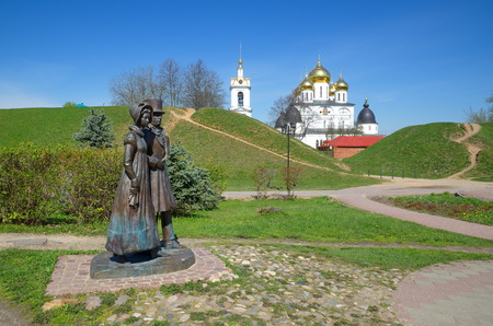 Dmitrov, Moscow region, Russia - may 15, 2017: The Sculptural composition The Nobles from the series Citizens against the background of the Assumption Cathedral of the Dmitrov Kremlin Editorial