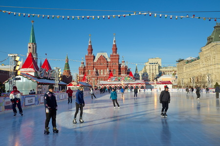 Moscow, Russia - December 7, 2016: The GUM-skating rink on Red square. People ride on skates