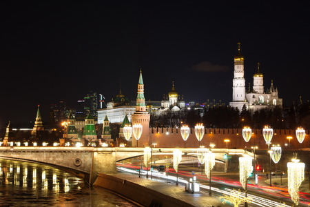 Evening view of Moscow Kremlin and Moskvoretskaya embankment with Christmas illuminations, Moscow, Russia