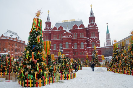 Moscow, Russia - February 8, 2018: The Festival Moscow Maslenitsa 2018 at the Manege square. Decorated fir trees with symbols of Shrovetide