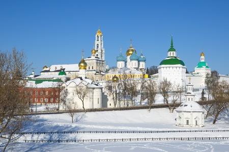 View from Blinnaya hill of the snow-covered architectural ensemble of Holy Trinity - St. Sergius Lavra with Chapel of Pyatnitsky Well in front of the monanastery, Moscow region, Russia Stock Photo
