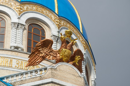 Double-headed eagle on the facade of the Church of the Holy Trinity in honor of the Millennium of the Baptism of Russia in Orekhovo-Borisovo, Moscow, Russia