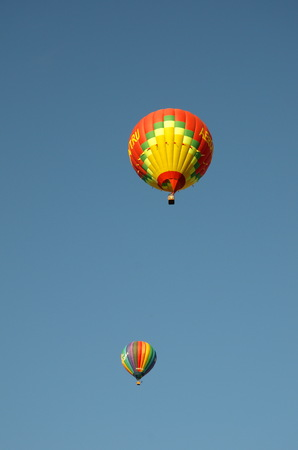 Two balloons against the blue sky