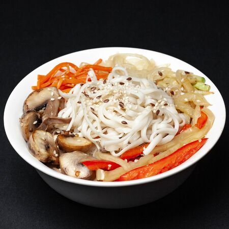 tasty noodles with meat on a black background. menu Фото со стока