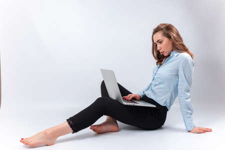 smiling businesswoman with laptop on her lap. isolated Фото со стока - 165396480