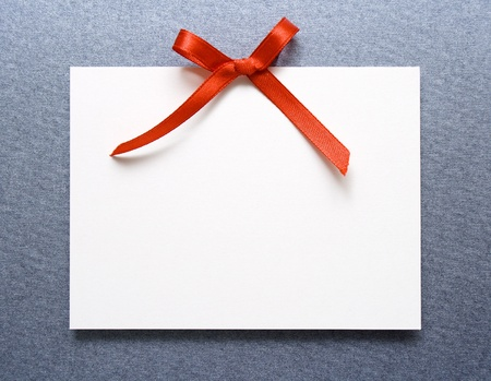Blank gift tag with red bow photo