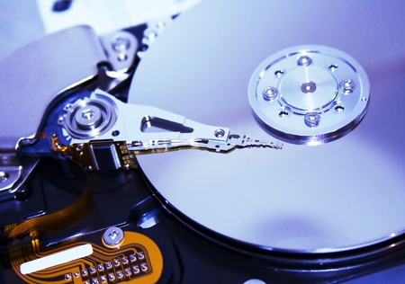 Close up of modern opened hard disk drive  photo