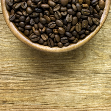 coffee beans on wood bowl photo