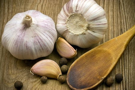 garlic on rough chopping board photo