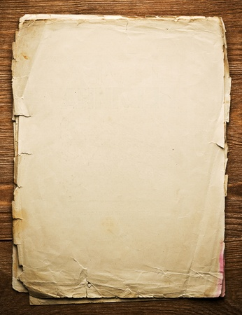 scroll up: old paper on brown wood texture with natural patterns
