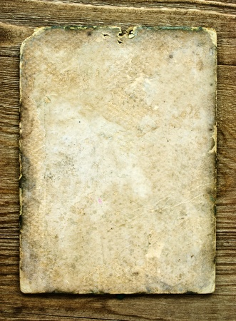 old paper on brown wood texture with natural patterns  photo