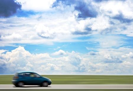 roadways: High-speed motion-blurred auto on rural highway