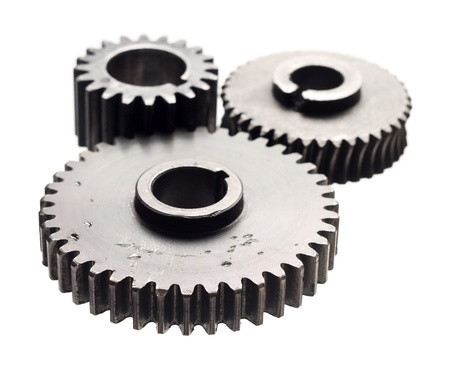 interlink: Assorted metal gears on white