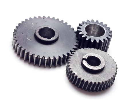 Assorted metal gears on white