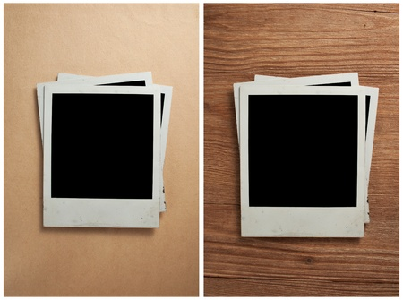 Old photo frames on the old paper and wooden background photo