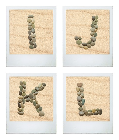 Alphabet. Picture Frames featuring characters from sea stones in the sand. Four letters. photo